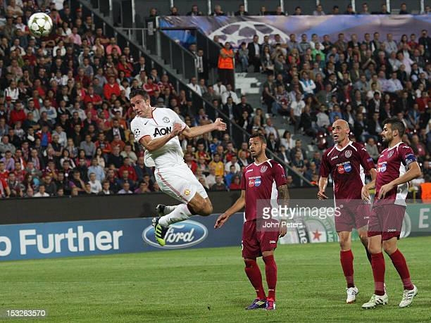 Robin van Persie of Manchester United scores their first goal during the UEFA Champions League Group H match between CFR 1907 Cluj and Manchester...