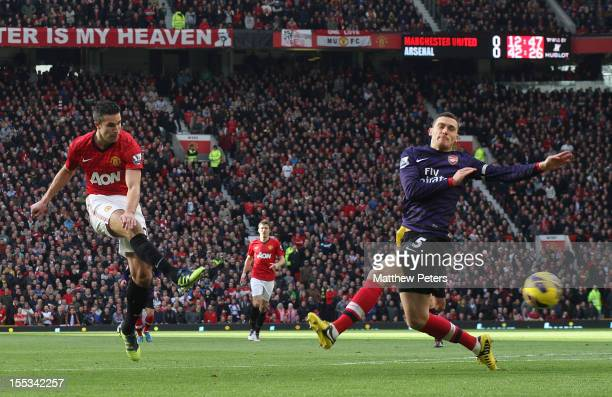 Robin van Persie of Manchester United scores their first goal during the Barclays Premier League match between Manchester United and Arsenal at Old...