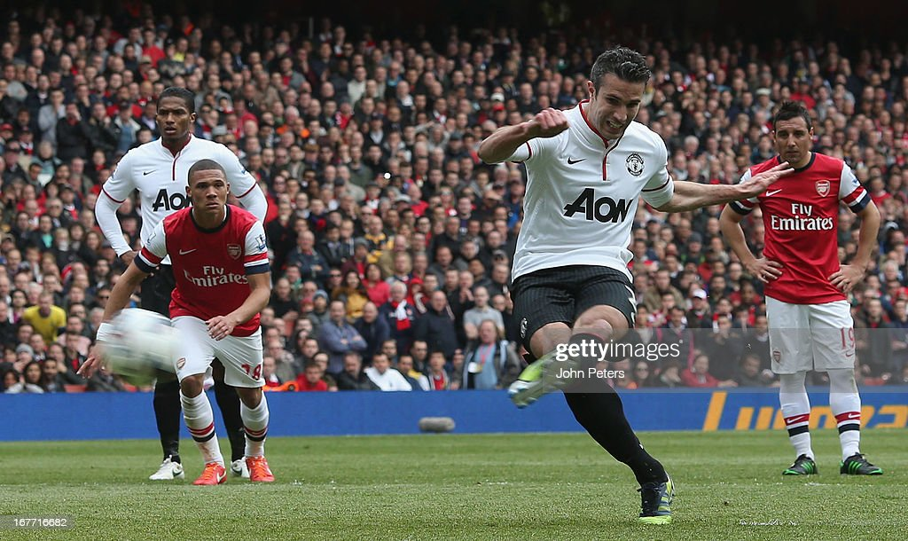 Robin van Persie of Manchester United scores their first goal during the Barclays Premier League match between Arsenal and Manchester United at Emirates Stadium on April 28, 2013 in London, England.