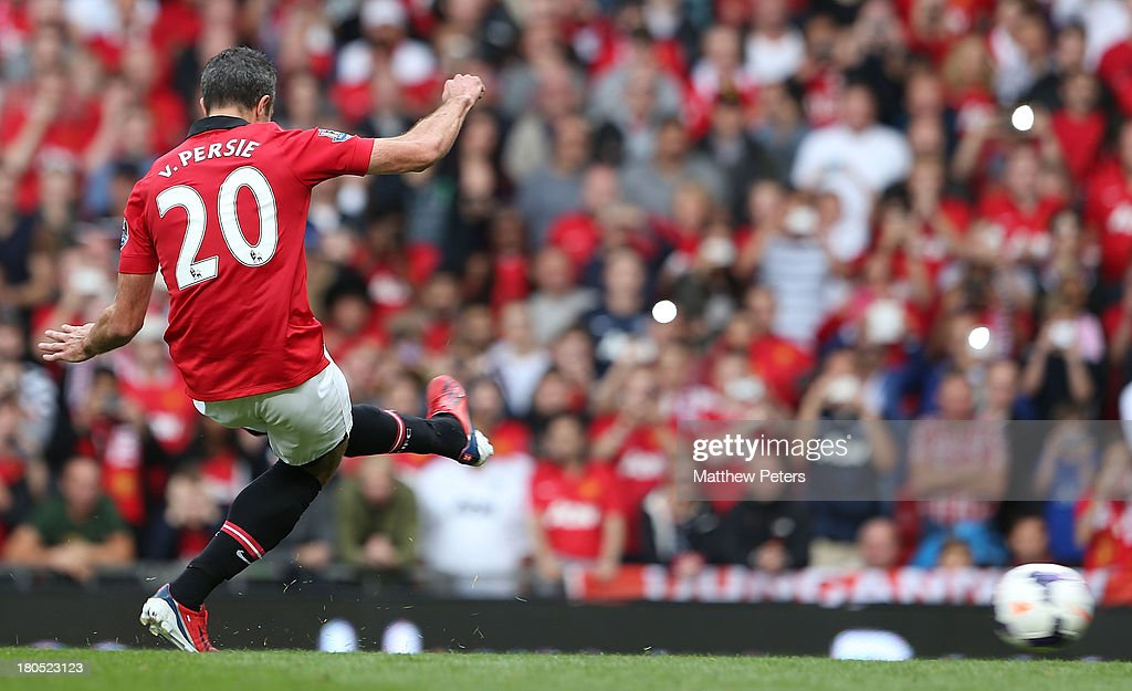 Robin van Persie of Manchester United scores their first goal during the Barclays Premier League match between Manchester United and Crystal Palace at Old Trafford on September 14, 2013 in Manchester, England.