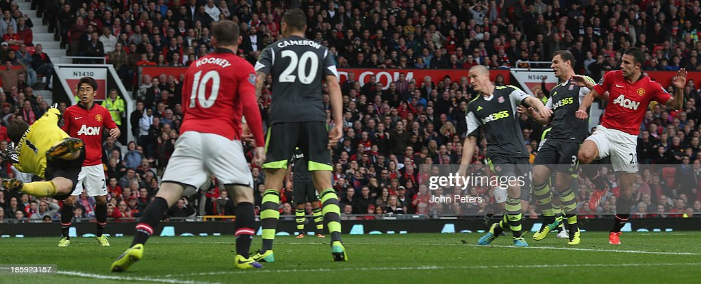 Robin van Persie of Manchester United scores their first goal during the Barclays Premier League match between Manchester United and Stoke City at Old Trafford on October 26, 2013 in Manchester, England.