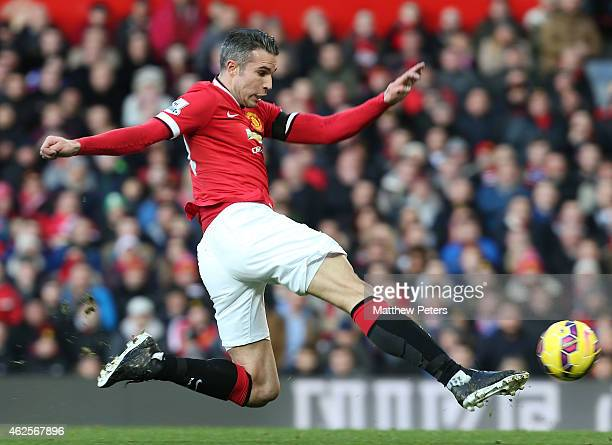 Robin van Persie of Manchester United scores their first goal during the Barclays Premier League match between Manchester United and Leicester City...