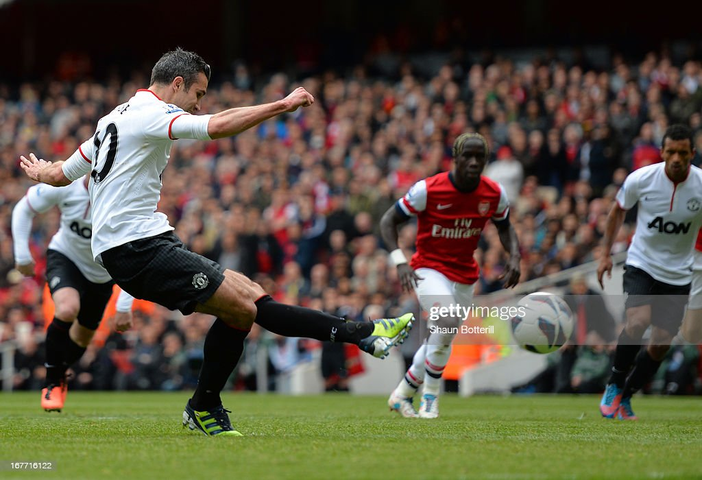 Robin van Persie of Manchester United scores their first goal from the penalty spot during the Barclays Premier League match between Arsenal and Manchester United at Emirates Stadium on April 28, 2013 in London, England.