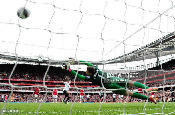 Robin van Persie of Manchester United scores their first goal from the penalty spot past Wojciech Szczesny of Arsenal during the Barclays Premier...