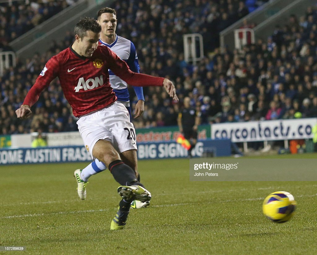 Robin van Persie of Manchester United scores their fourth goal during the Barclays Premier League match between Reading and Manchester United at Madejski Stadium on December 1, 2012 in Reading, England.