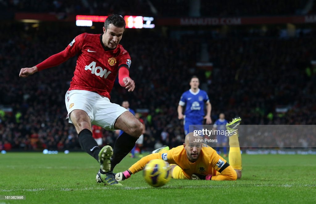 Robin van Persie of Manchester United scores their second goal during the Barclays Premier League match between Manchester United and Everton at Old Trafford on February 10, 2013 in Manchester, England.