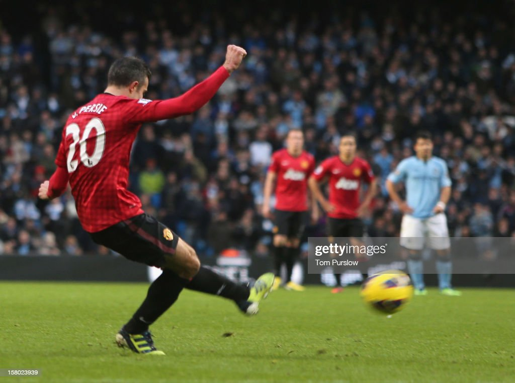 Robin van Persie of Manchester United scores their third goal during the Barclays Premier League match between Manchester City and Manchester United at Etihad Stadium on December 9, 2012 in Manchester, England.