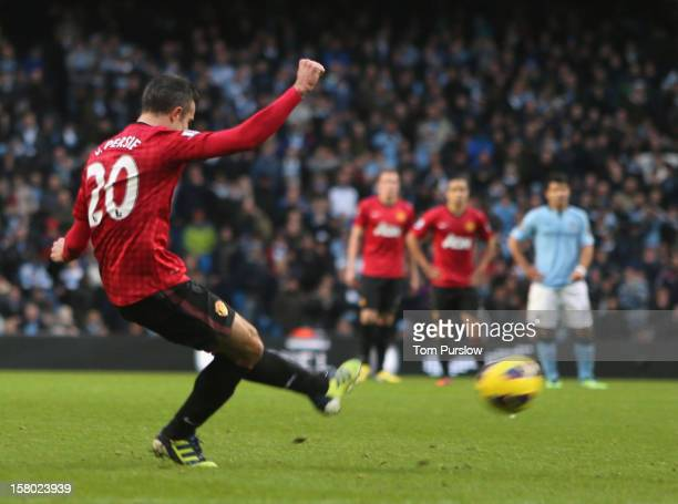Robin van Persie of Manchester United scores their third goal during the Barclays Premier League match between Manchester City and Manchester United...