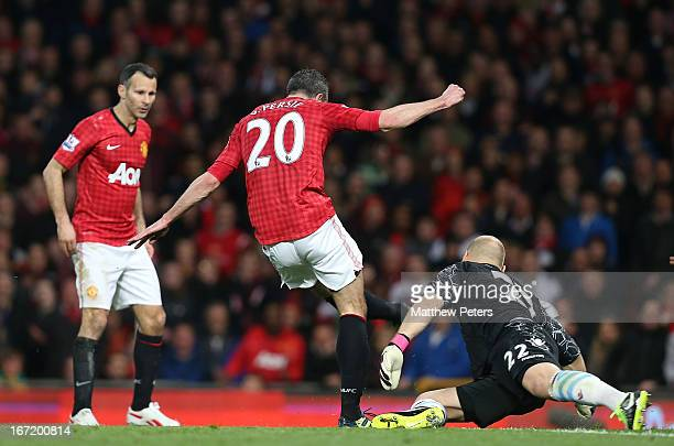 Robin van Persie of Manchester United scores their third goal during the Barclays Premier League match between Manchester United and Aston Villa at...