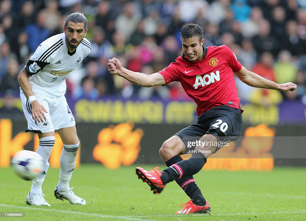 Robin van Persie of Manchester United scores their third goal during the Barclays Premier League match between Swansea City and Manchester United at the Liberty Stadium on August 17, 2013 in Swansea, Wales.
