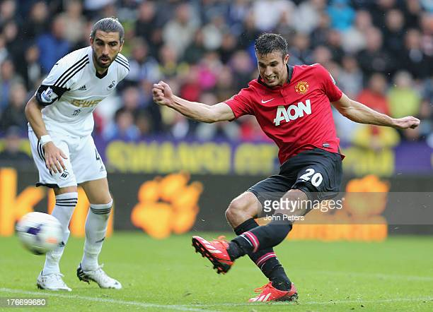 Robin van Persie of Manchester United scores their third goal during the Barclays Premier League match between Swansea City and Manchester United at...
