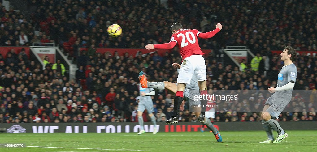 Robin van Persie of Manchester United scores their third goal during the Barclays Premier League match between Manchester United and Newcastle United...