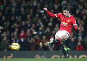 Robin van Persie of Manchester United scores their third goal during the Barclays Premier League match between Manchester United and Burnley at Old...