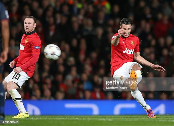 Robin van Persie of Manchester United scores their third goal during the UEFA Champions League Round of 16 second leg match between Manchester United...