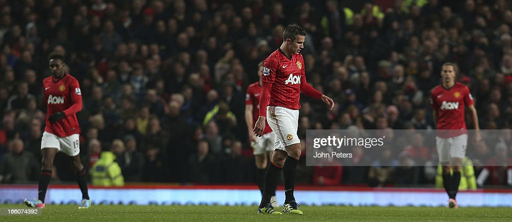 Robin van Persie of Manchester United shows his disappointment at conceding a goal during the Barclays Premier League match between Manchester United and Manchester City at Old Trafford on April 8, 2013 in Manchester, England.