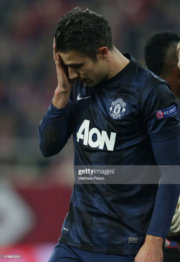 Robin van Persie of Manchester United shows his disappointment during the UEFA Champions League Round of 16 match between Olympiacos FC and Manchester United at Karaiskakis Stadium on February 25, 2014 in Piraeus, Greece.