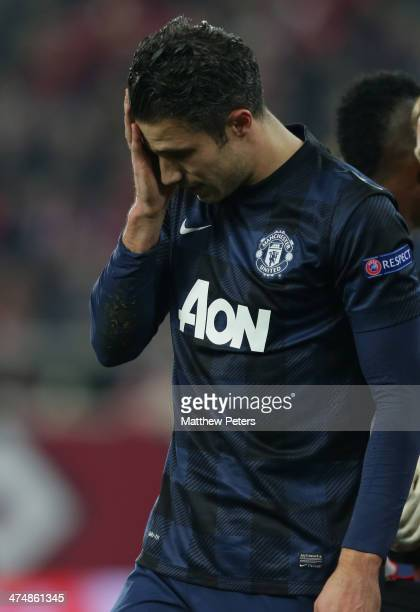 Robin van Persie of Manchester United shows his disappointment during the UEFA Champions League Round of 16 match between Olympiacos FC and...
