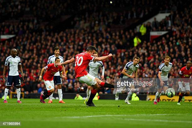 Robin van Persie of Manchester United takes a penalty which is saved by Boaz Myhill of West Brom during the Barclays Premier League match between...