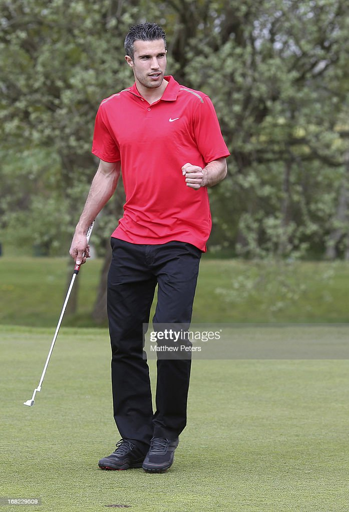 Robin van Persie of Manchester United takes part in a Players v Coaching Staff golf match at Dunham Massey Golf Club on May 7, 2013 in Manchester, England.