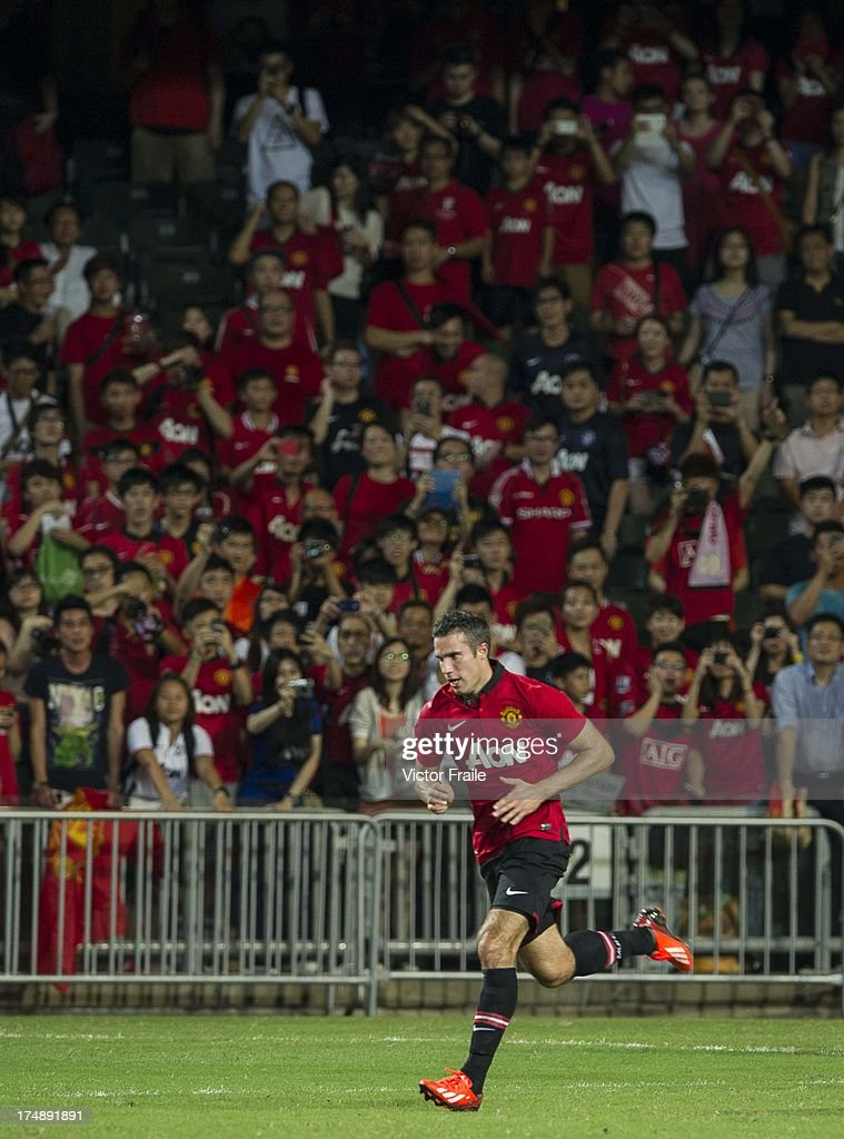 Robin Van Persie of Manchester United warms up after the international friendly match between Kitchee FC and Manchester United at Hong Kong Stadium on July 29, 2013 in So Kon Po, Hong Kong.