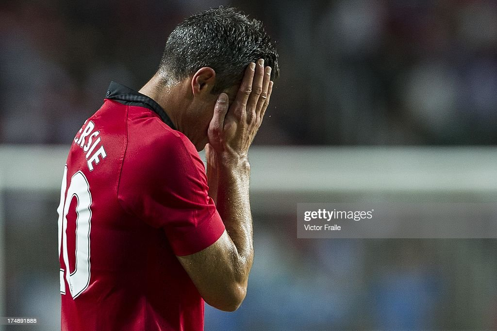 Robin Van Persie of Manchester United wipes his face during the international friendly match between Kitchee FC and Manchester United at Hong Kong Stadium on July 29, 2013 in So Kon Po, Hong Kong.
