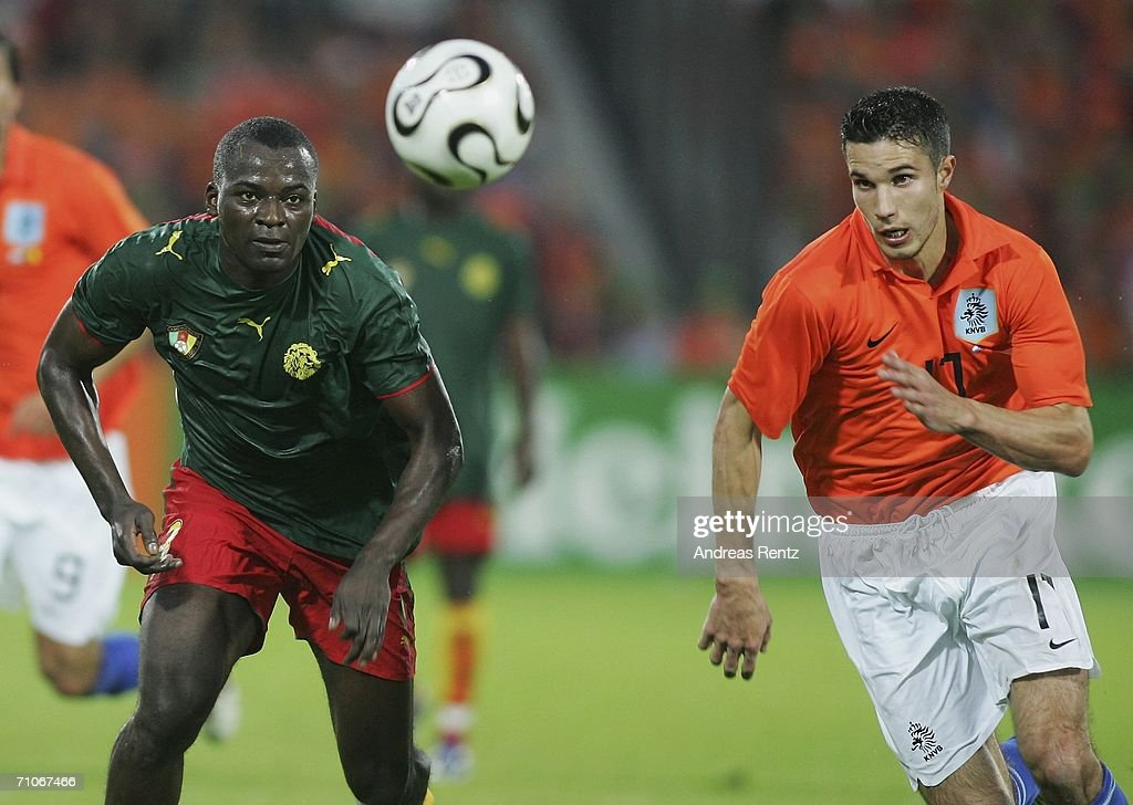 Robin van Persie of Netherlands vies for the ball with Timothee Atouba of Cameroon during the international friendly match between Netherlands and...