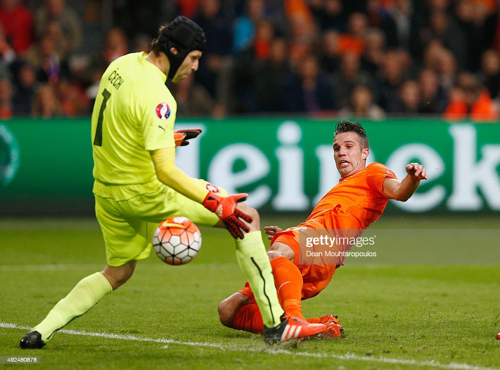 Robin van Persie of the Netherlands beats goalkeeper Petr Cech of the Czech Republic as scores their second goal and his 50th in international...