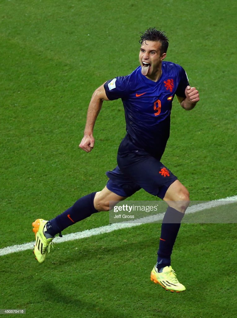 Robin van Persie of the Netherlands celebrates after scoring his second goal and his team's fourth during the 2014 FIFA World Cup Brazil Group B match between Spain and Netherlands at Arena Fonte Nova on June 13, 2014 in Salvador, Brazil.