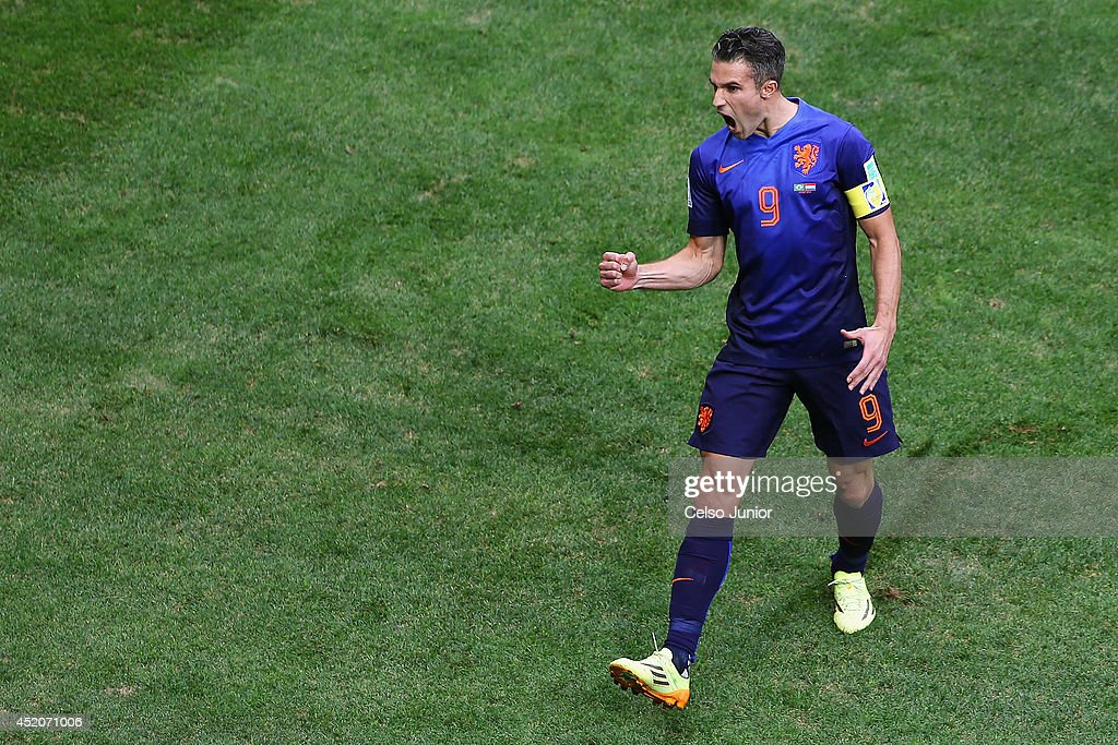 Robin van Persie of the Netherlands celebrates scoring his team's first goal on a penalty kick during the 2014 FIFA World Cup Brazil Third Place Playoff match between Brazil and the Netherlands at Estadio Nacional on July 12, 2014 in Brasilia, Brazil.