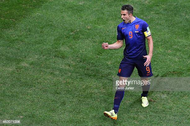 Robin van Persie of the Netherlands celebrates scoring his team's first goal on a penalty kick during the 2014 FIFA World Cup Brazil Third Place...