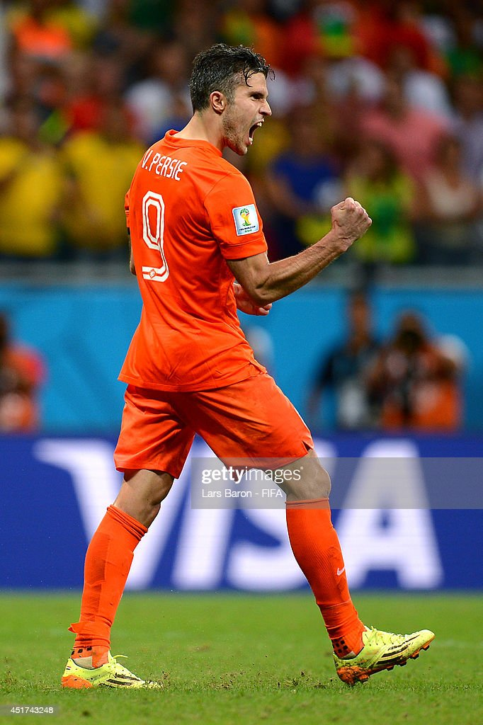 Robin van Persie of the Netherlands celebrates scoring in the penalty shootout during the 2014 FIFA World Cup Brazil Quarter Final match between Netherlands and Costa Rica at Arena Fonte Nova on July 5, 2014 in Salvador, Brazil.