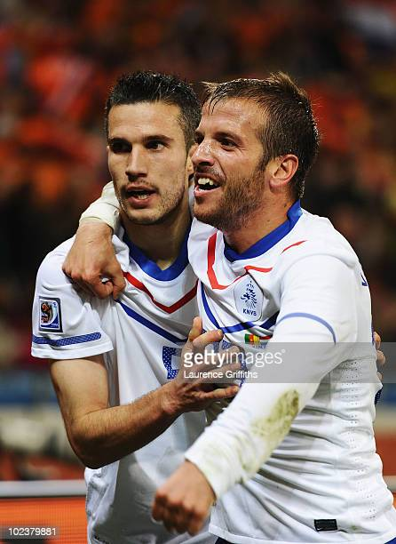 Robin Van Persie of the Netherlands celebrates scoring the opening goal with team mate Rafael Van der Vaart during the 2010 FIFA World Cup South...