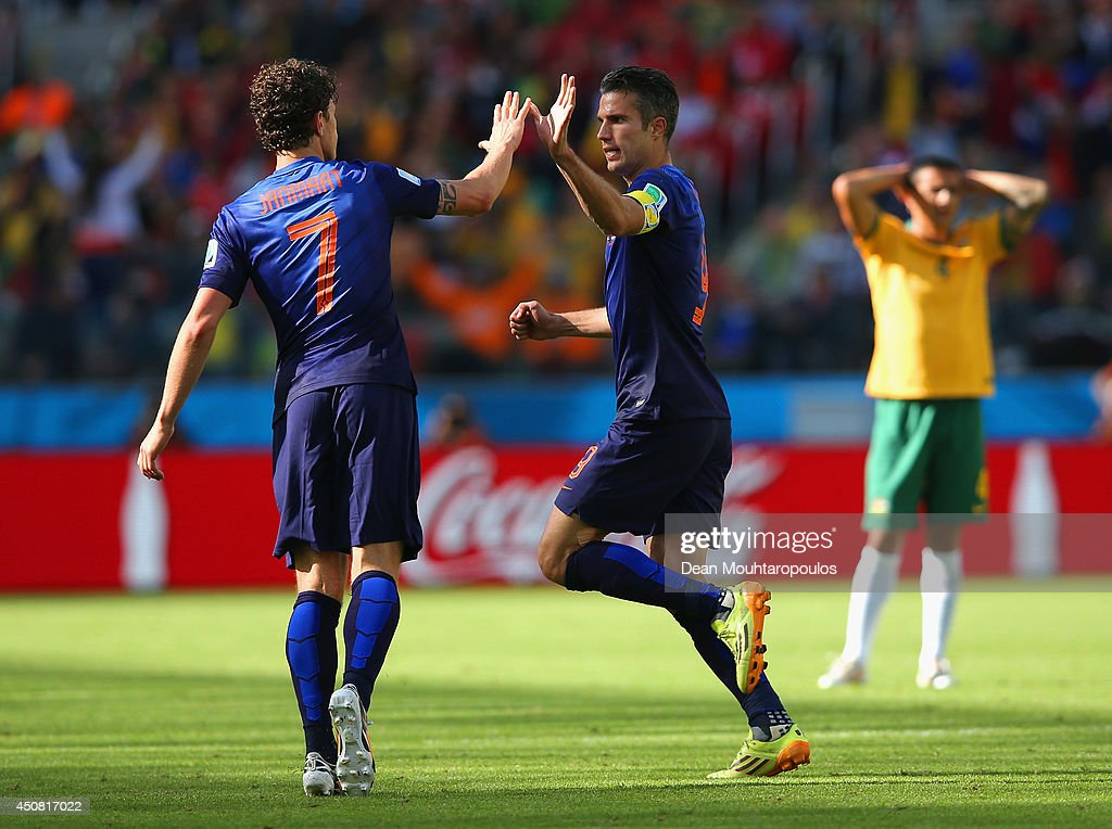 Robin van Persie of the Netherlands celebrates with <a gi-track='captionPersonalityLinkClicked' href=/galleries/search?phrase=Daryl+Janmaat&family=editorial&specificpeople=6134960 ng-click='$event.stopPropagation()'>Daryl Janmaat</a> after scoring the second goal during the 2014 FIFA World Cup Brazil Group B match between Australia and Netherlands at Estadio Beira-Rio on June 18, 2014 in Porto Alegre, Brazil.