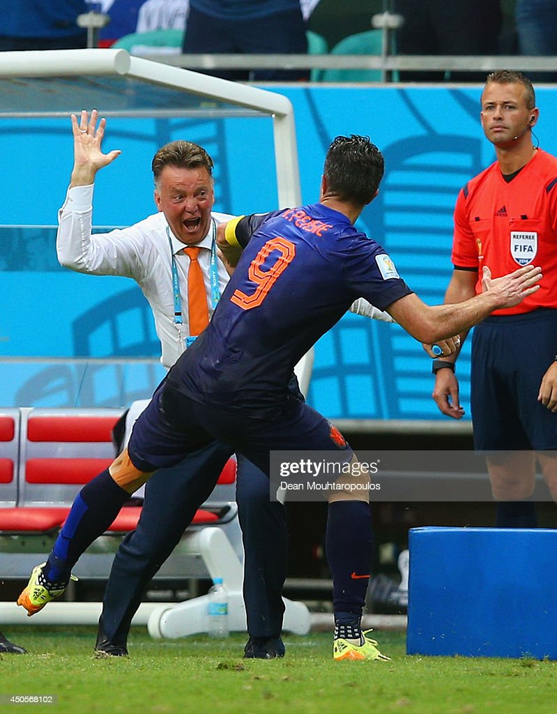 Robin van Persie of the Netherlands celebrates with head coach Louis van Gaal after scoring the team's first goal in the first half during the 2014 FIFA World Cup Brazil Group B match between Spain and Netherlands at Arena Fonte Nova on June 13, 2014 in Salvador, Brazil.