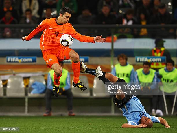 Robin Van Persie of the Netherlands in action against Egidio Arevalo of Uruguay during the 2010 FIFA World Cup South Africa Semi Final match between...