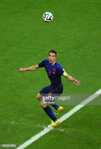 Robin van Persie of the Netherlands lines up the ball prior to scoring his team's first goal with a header in the first half during the 2014 FIFA...