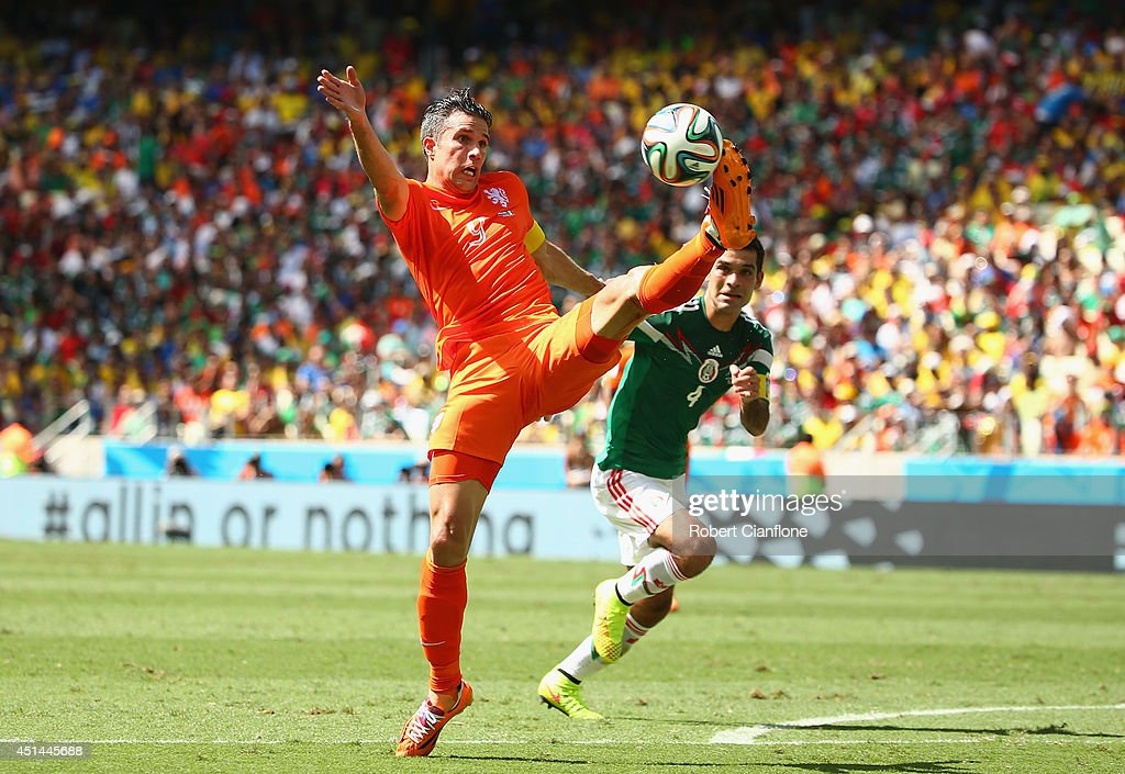 Robin van Persie of the Netherlands reaches for the ball during the 2014 FIFA World Cup Brazil Round of 16 match between Netherlands and Mexico at Castelao on June 29, 2014 in Fortaleza, Brazil.