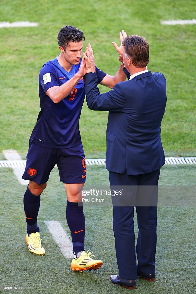 Robin van Persie of the Netherlands reacts with head coach Louis van Gaal as he exits the game during the 2014 FIFA World Cup Brazil Group B match between Australia and Netherlands at Estadio Beira-Rio on June 18, 2014 in Porto Alegre, Brazil.