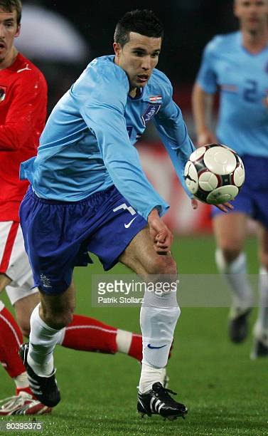 Robin van Persie of the Netherlands runs with the ball during the international friendly match between Austria and Netherlands at the Ernst Happel...