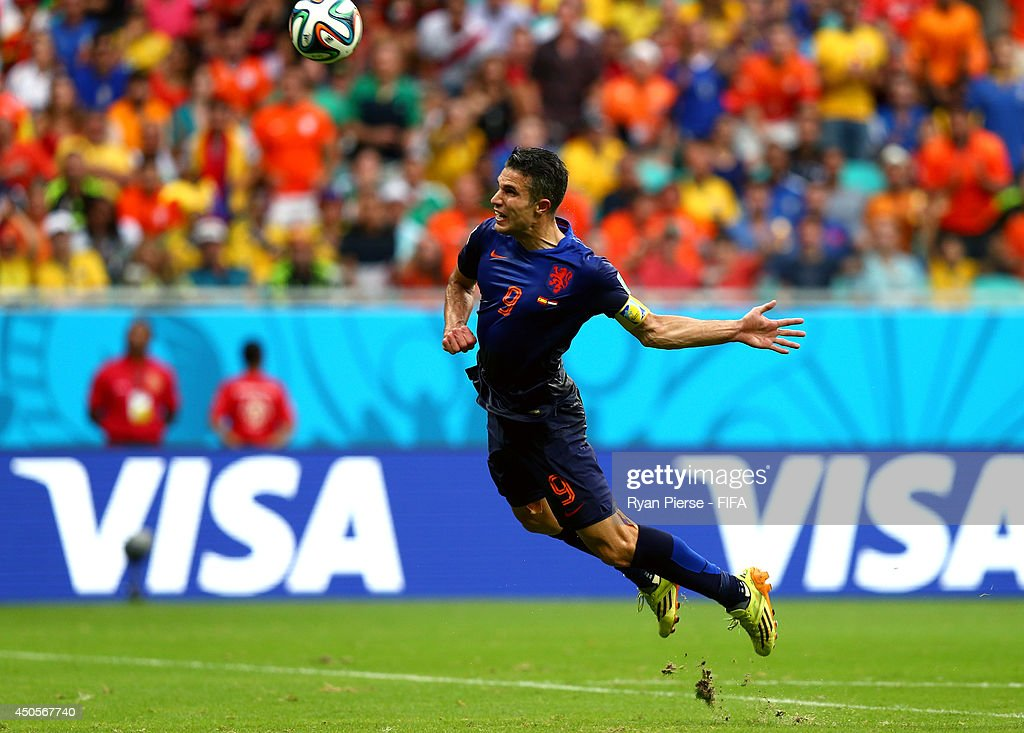 Robin van Persie of the Netherlands scores the equalising goal during the 2014 FIFA World Cup Brazil Group B match between Spain and Netherlands at Arena Fonte Nova on June 13, 2014 in Salvador, Brazil.