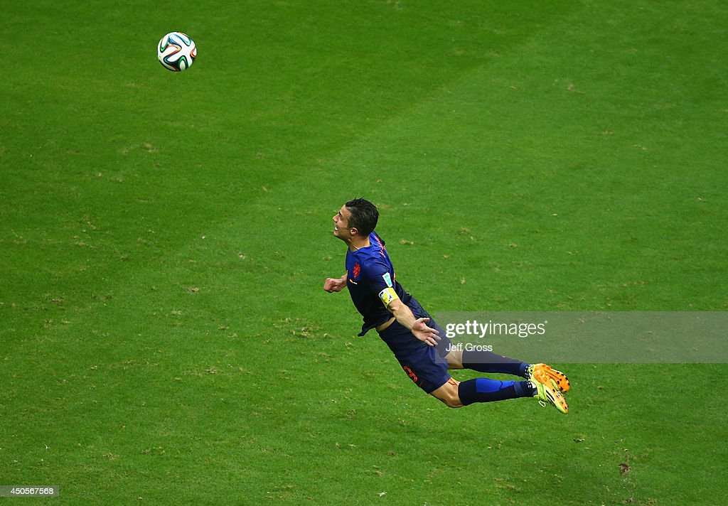 Robin van Persie of the Netherlands scores the team's first goal with a diving header in the first half during the 2014 FIFA World Cup Brazil Group B match between Spain and Netherlands at Arena Fonte Nova on June 13, 2014 in Salvador, Brazil.