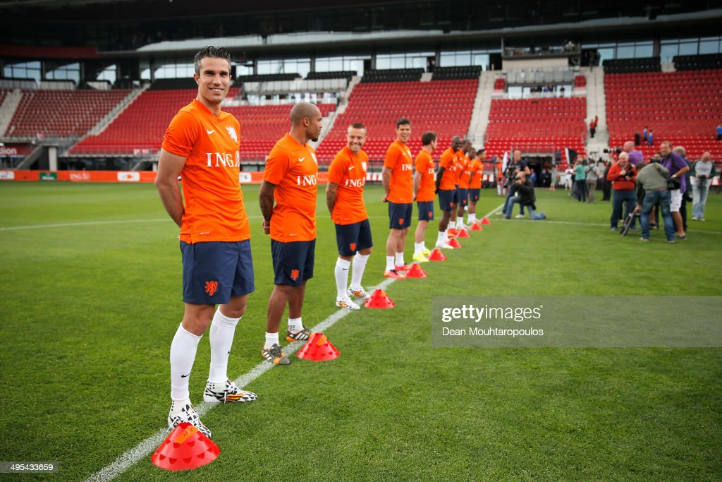 <a gi-track='captionPersonalityLinkClicked' href=/galleries/search?phrase=Robin+Van+Persie&family=editorial&specificpeople=214179 ng-click='$event.stopPropagation()'>Robin Van Persie</a> (L) of the Netherlands smiles as he waits for photographers to take his portrait prior to the Netherlands training session held at the AFAS Stadion on June 3, 2014 in Alkmaar, Netherlands.