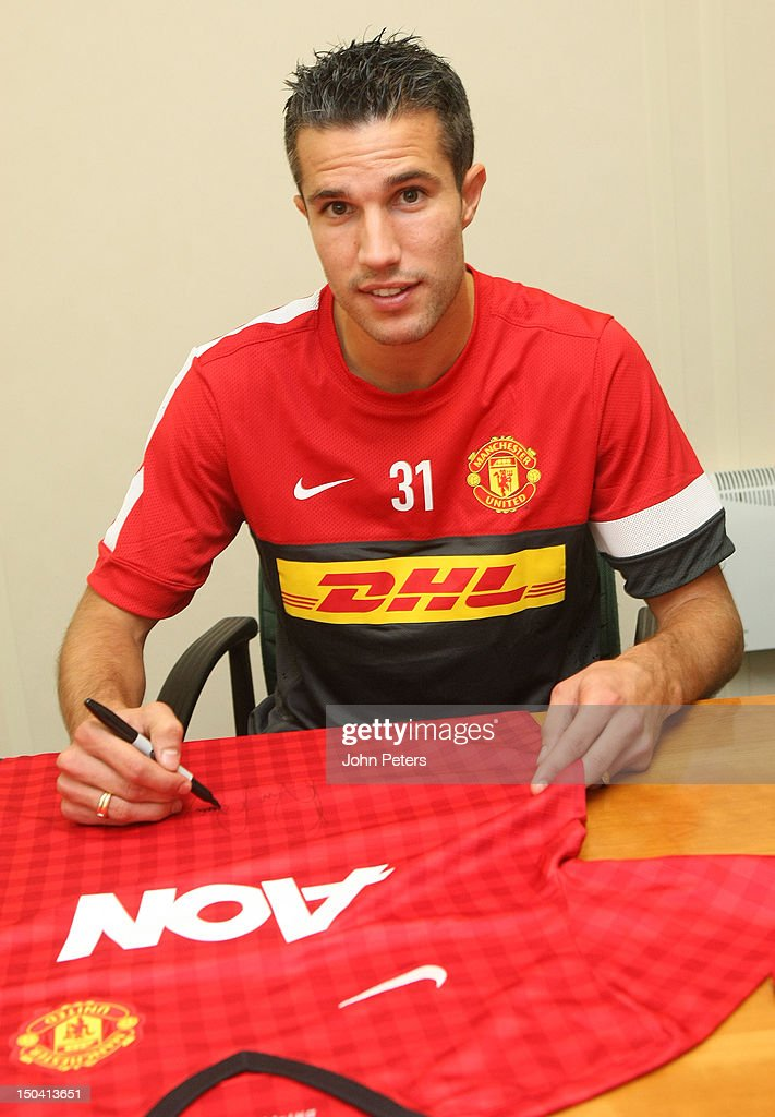 Robin van Persie poses as he signs for Manchester United FC at their Carrington Training Ground on August 17, 2012 in Manchester, England.