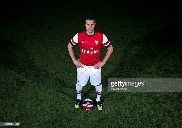 Robin van Persie poses during a photoshoot for the new Arsenal home kit for season 2012/13 at London Colney on April 5 2012 in St Albans England
