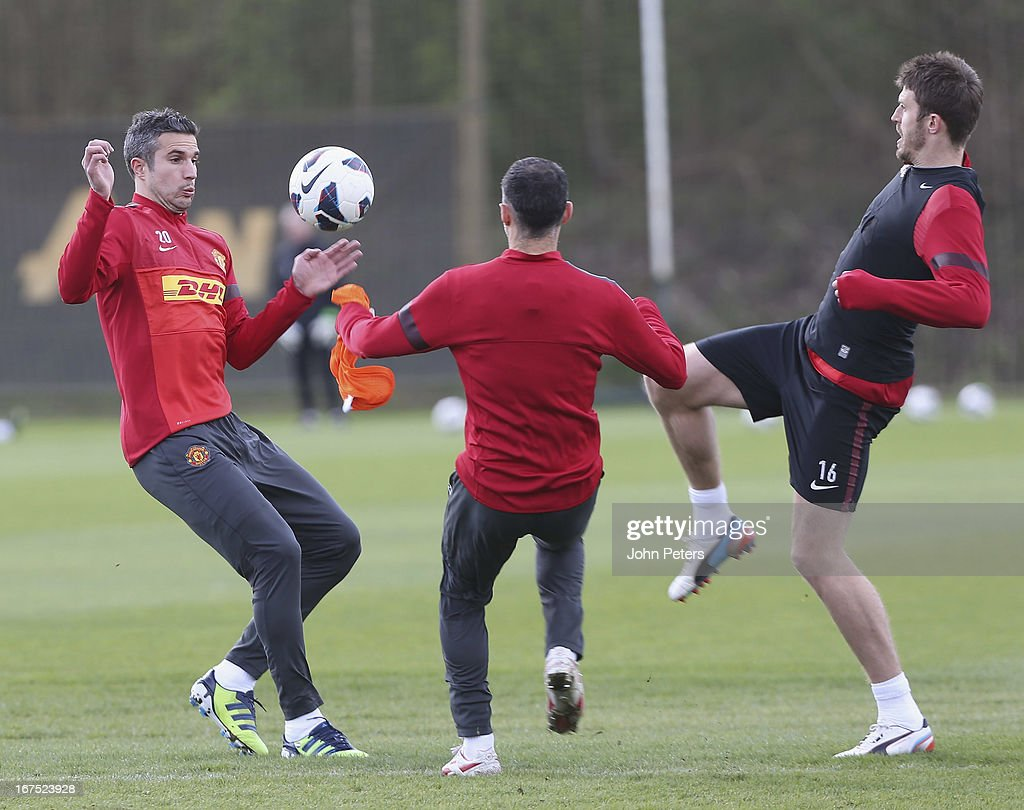 Robin van Persie, Ryan Giggs and Michael Carrick of Manchester United in actoin during a first team training session at Carrington Training Ground on April 26, 2013 in Manchester, England.