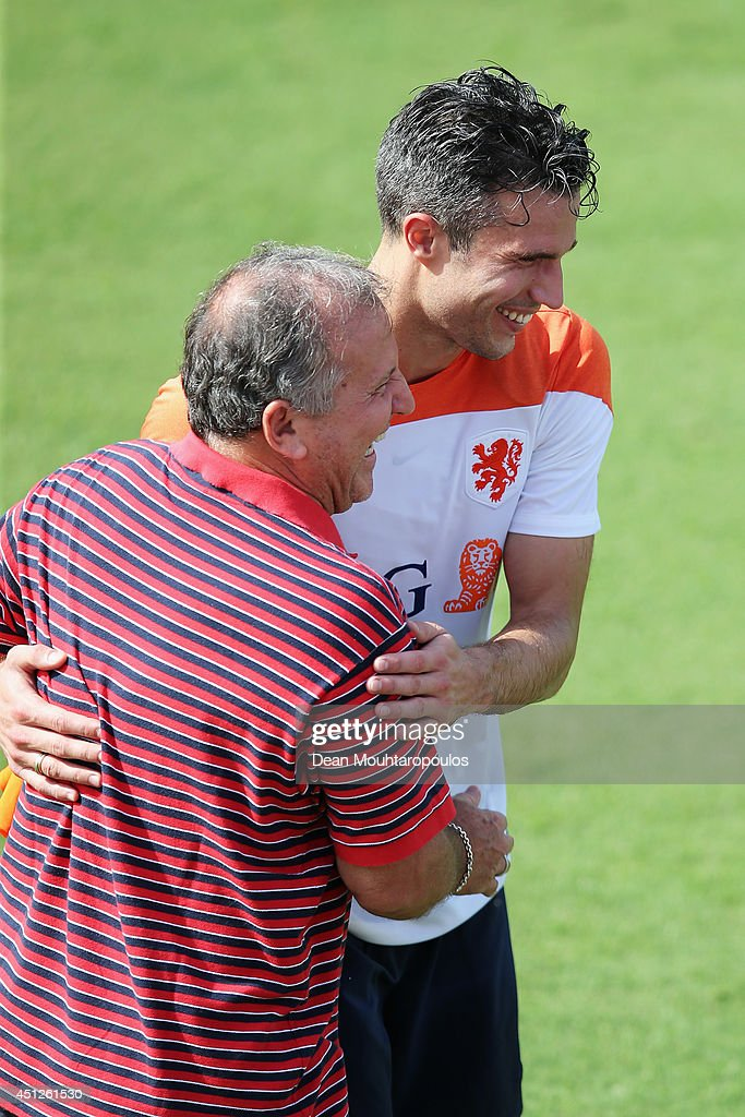 Robin van Persie speaks and shares a joke with Brazilian football Legend Zico during the Netherlands training session at the 2014 FIFA World Cup...