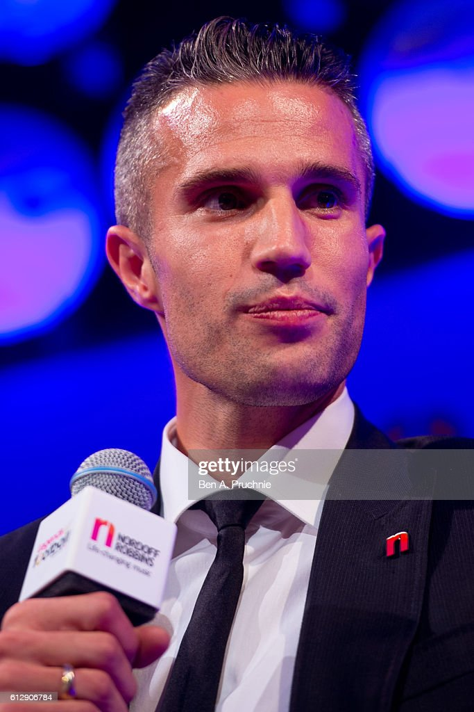 Robin van Persie speaks on stage during the 21st Legends of football event to celebrate 25 seasons of the Premier League and raise money for music therapy charity Nordoff Robbins at The Grosvenor House Hotel