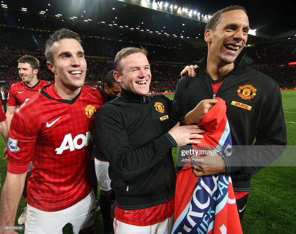 Robin van Persie, <a gi-track='captionPersonalityLinkClicked' href=/galleries/search?phrase=Wayne+Rooney&family=editorial&specificpeople=157598 ng-click='$event.stopPropagation()'>Wayne Rooney</a> and <a gi-track='captionPersonalityLinkClicked' href=/galleries/search?phrase=Rio+Ferdinand&family=editorial&specificpeople=157538 ng-click='$event.stopPropagation()'>Rio Ferdinand</a> of Manchester United celebrates on the pitch after the Barclays Premier League match between Manchester United and Aston Villa at Old Trafford on April 22, 2013 in Manchester, England.