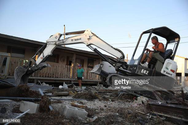 Robin Weeks and Dan Weeks clear the lot where their mobile home once stood before hurricane Irma passed through the area on September 18 2017 in...
