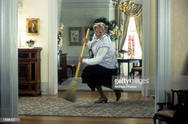 Robin Williams brooms in a scene from the film 'Mrs Doubtfire' 1993